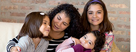 A mother engages with her children, utilizing the parent solutions offered by Office Depot OfficeMax.